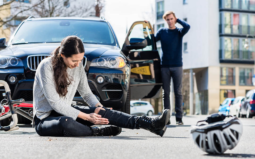 Auto Accident in which a car hit a cyclist